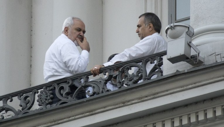 Iranian Foreign Minister Mohammad Javad Zarif (L) and Hossein Fereydoun, the brother of the Iranian president, talk during  abreak onto a balcony of the Palais Coburg Hotel, where the Iran nuclear talks meetings are being held in Vienna on July 11, 2015.  (Joe Klamar/AFP)