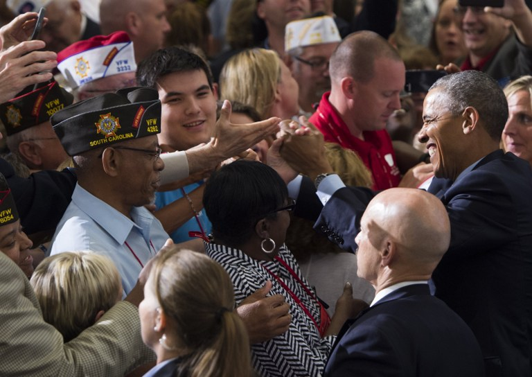 US President Barack Obama greets attendees after speaking at the 116th National Convention of the Veterans of Foreign Wars (VFW) at the David Lawrence Convention Center in Pittsburgh, Pennsylvania on July 21, 2015. (Saul Loeb/AFP)
