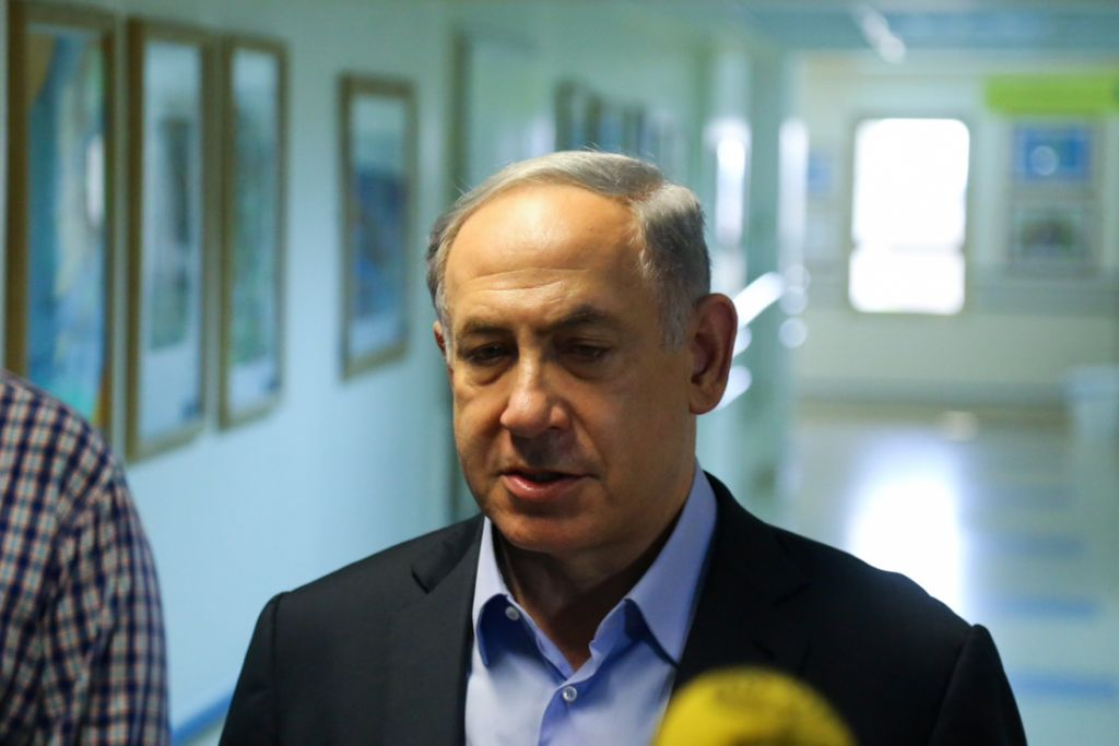 Prime Minister Benjamin Netanyahu gives a press statement after visiting the Dawabsha family at the hospital following an arson attack by alleged Jewish extremists in the Palestinian village of Duma, near Nablus, where the Dawabsha's infant son Ali was killed, and the rest of the family injured, on July 31, 2015. (Photo by FLASH90)