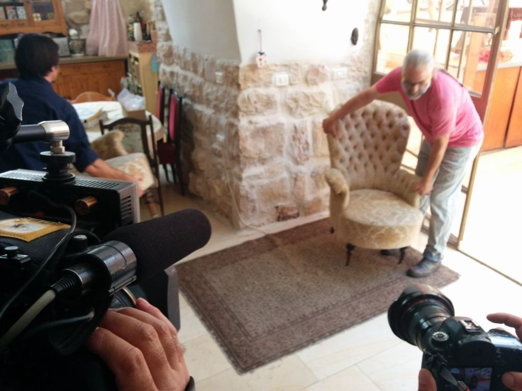 Tal Shimoni reveals the entrance to a first century Jewish ritual bath in his home in Ein Karem, on July 1, 2015. (Ilan Ben Zion/Times of Israel staff)