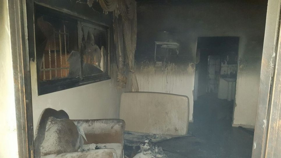 The burned-down home of the Dawabsha family in the Palestinian village of Duma, in the Nablus area, July 31, 2015 (Zacharia Sadeh/Rabbis for Human Rights)