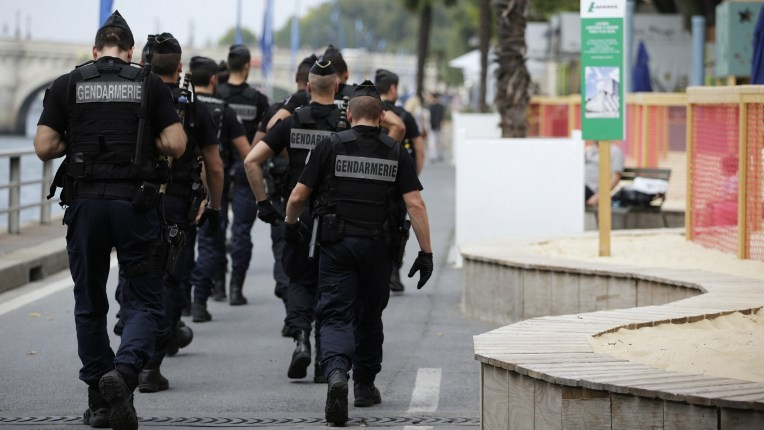 "Gendarmes walk on  the quay of the river where is held ""Gaza Plages"" (Gaza Beach), near the ""Tel-Aviv sur Seine"" beach attraction during the 14th edition of Paris Plages (Paris Beaches) in central Paris, on August 13, 2015. The ""Tel-Aviv sur Seine"" attraction sparked uproar among some left-wing politicians and pro-Palestinian groups, and protesters have vowed to celebrate a ""Gaza Beach"" nearby.  (Kenzo Tribouillard/AFP)"