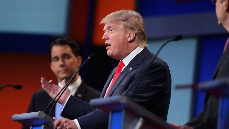 Republican presidential candidates Wisconsin Gov. Scott Walker (left) and Donald Trump participate in the first prime-time presidential debate in Cleveland, Ohio, August 6, 2015. (Scott Olson/Getty Images/AFP)