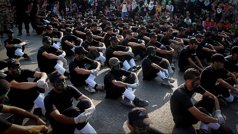 Palestinian youth show their skills during a graduation ceremony as part of a military-style summer camp organised by the Izzadin al-Qassam brigades, the armed wing of Hamas, on August 5, 2015, in Khan Younis. (Abed Rahim Khatib/ Flash90)