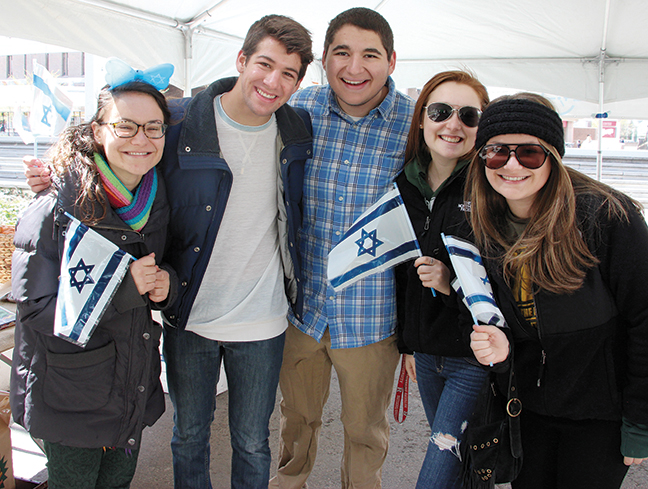 Rutgers Hillel students stand together to celebrate Yom Ha'atzmaut.