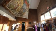 "Attendees of the official unveiling of the ""Lost Shul"" Mural at the Ohavi Zedek Synagogue see the mural for the first time. RNS"