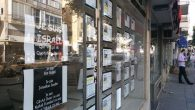A Tel Aviv real estate brokerage firm with signs in French. Joshua Mitnick/JW