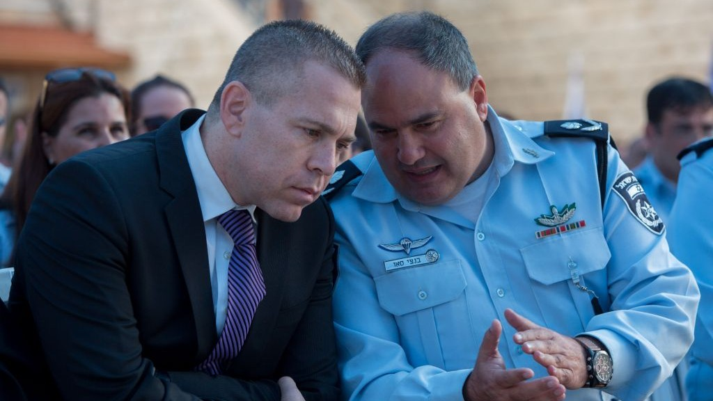 Public Security Minister Gilad Erdan (left) speaks with Deputy Police Commissioner Bentzi Sau in Jerusalem on September 7, 2015. (Yonatan Sindel/Flash90)