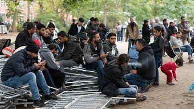 Illustrative photo of refugees waiting for registration outside the state office for health and social issues in Berlin, Germany, Friday, Sept. 25 2015 (Bernd von Jutrczenka/dpa via AP)