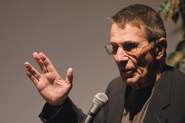 Leonard Nimoy, shown in 2002, demonstrates Spock's Vulcan salute, which he took from the traditional priestly blessing. (Michel Boutefeu/Getty Images)