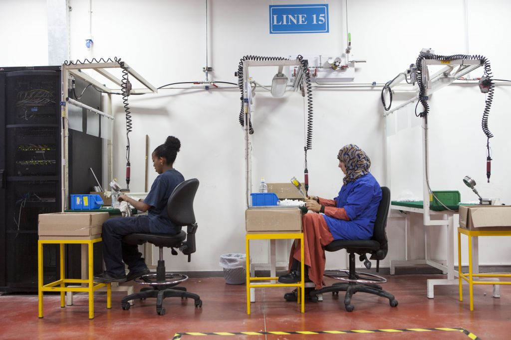 Employees work at the new SodaStream factory built deep in Israel's Negev Desert next to the city of Rahat, Israel, that will replace the West Bank facility when it shuts down in two weeks time, Wednesday, Sept. 2, 2015. The chief executive of SodaStream, Daniel Birnbaum announced the shuttering of its West Bank factory in the face of international boycott calls, accusing company critics of anti-Semitism, but the Boycott, Divestment and Sanctions (BDS) international boycott campaign declared a victory and said its pressure was behind the decision. (AP/Dan Balilty)