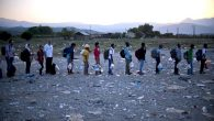 Migrants and refugees line up to register after crossing the Macedonian-Greek border this week. Getty Images