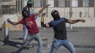 Palestinians throwing rocks at Israeli police during clashes in eastern Jerusalem, Sept. 18, 2015. JTA