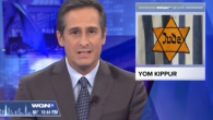 An anchor for the Chicago TV station WGN reporting the start of Yom Kippur with the Holocaust-era graphic in the background. JTA