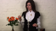In a Shaerith Israel video posted on YouTube, Alana Shultz demonstrates how to light Shabbat candles. YouTube