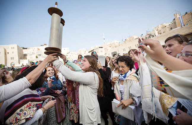 Women of the Wall members dance with the Torah scroll at its monthly prayer services at the Western Wall in Jerusalem on April 20.Miriam Alster/FLASH90