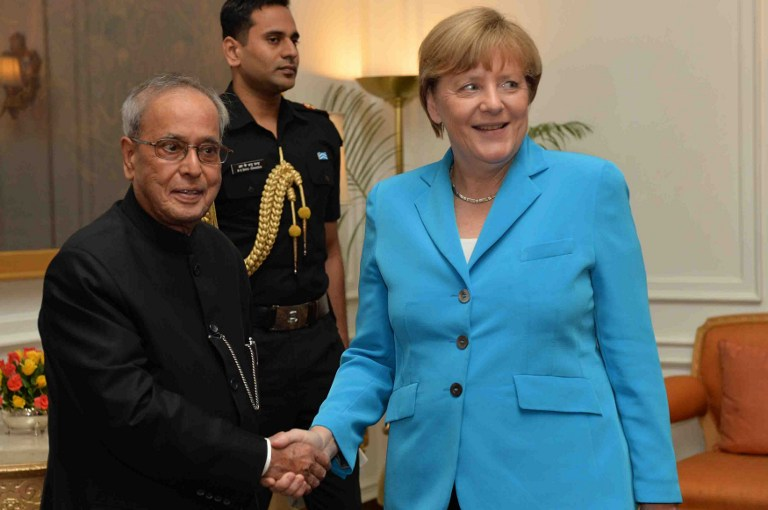 In this photograph received from the Presidential Palace on October 5, 2015, Indian President Pranab Mukherjee (L) shakes hands with Germany's Chancellor Angela Merkel during their meeting at the Presidential Palace in New Delhi. (Presidential Palace/AFP)
