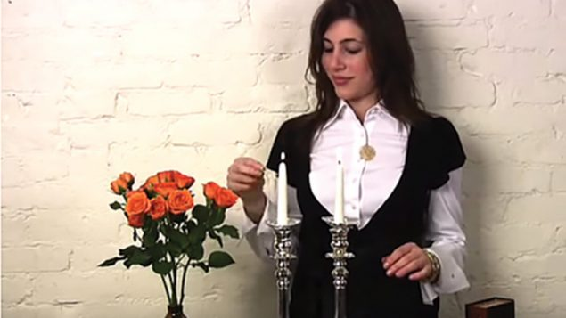 In a Shearith Israel video posted on YouTube,  Alana Shultz demonstrates how to light shabbat candles. Via youtube.com