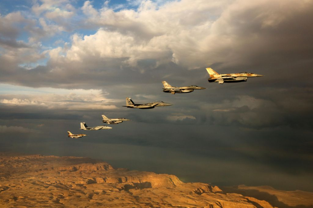 Israeli and foreign fighter jets fly in formation through cloudy skies over the Negev desert during the 'Blue Flag' exercise at Ovda Airfield near Eilat on Oct. 27, 2015. (Israel Air Force)
