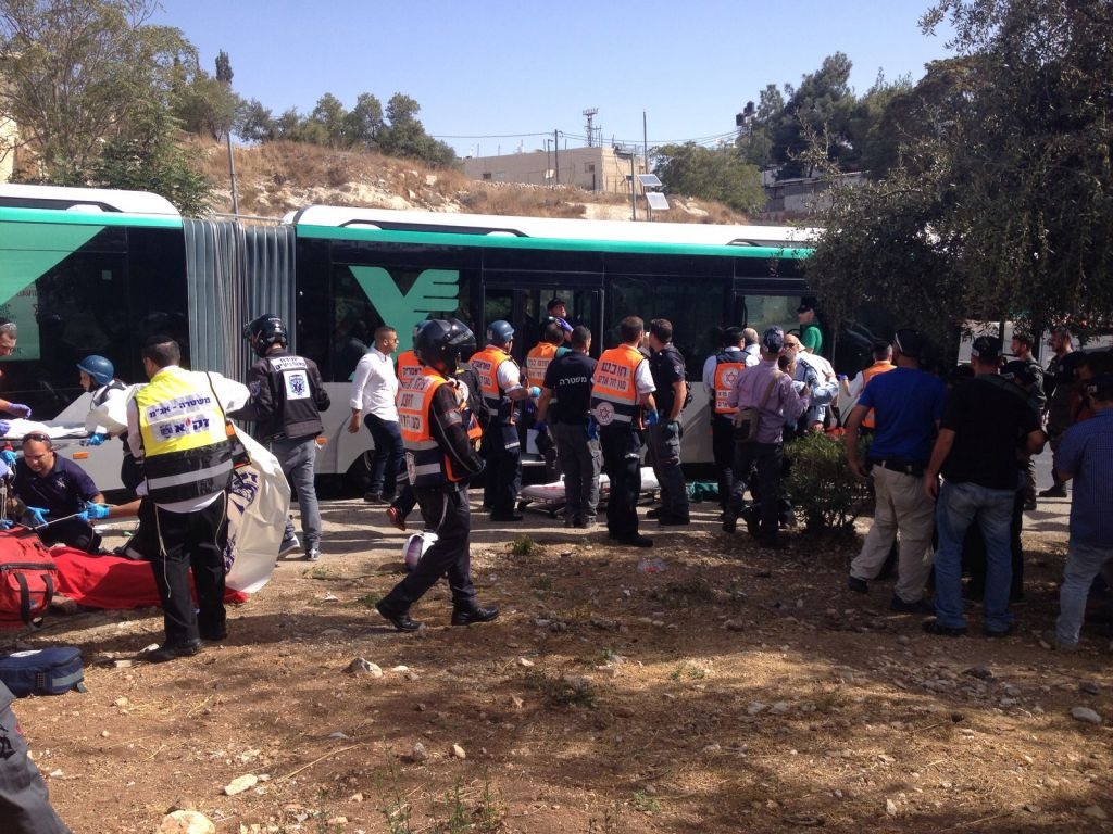 Police and emergency medical services treat the victims of a terror attack in the Armon Hanatziv neighborhood in Jerusalem on Oct. 13, 2015. (Israel Police)