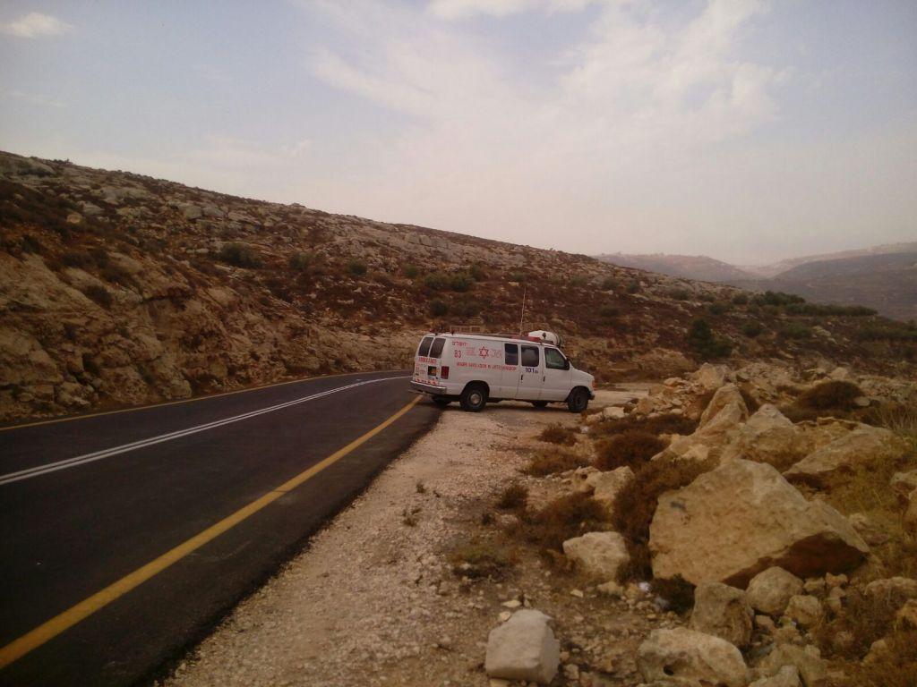 An ambulance is seen on a road in the West Bank where a man was stabbed by a Palestinian terrorist on Sunday