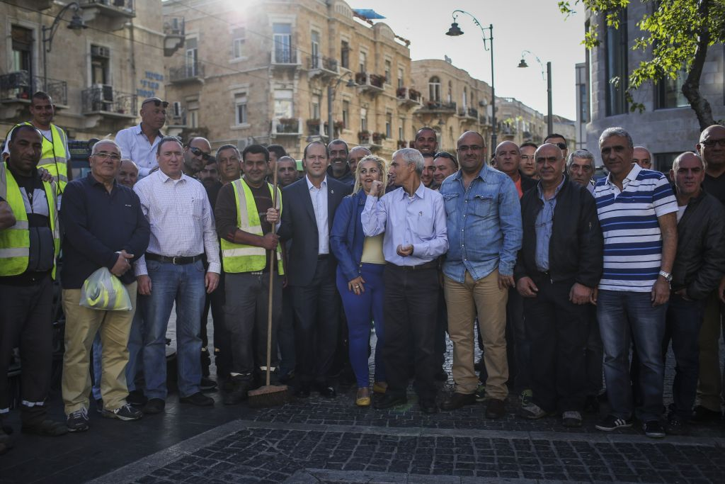 Mayor Nir Barkat and a crew of Jerusalem sanitation workers in April 2014; the municipality does not have any data about the number of Arabs working in custodial positions in the city, said a city spokesperson (Hadas Parush/Flash 90)