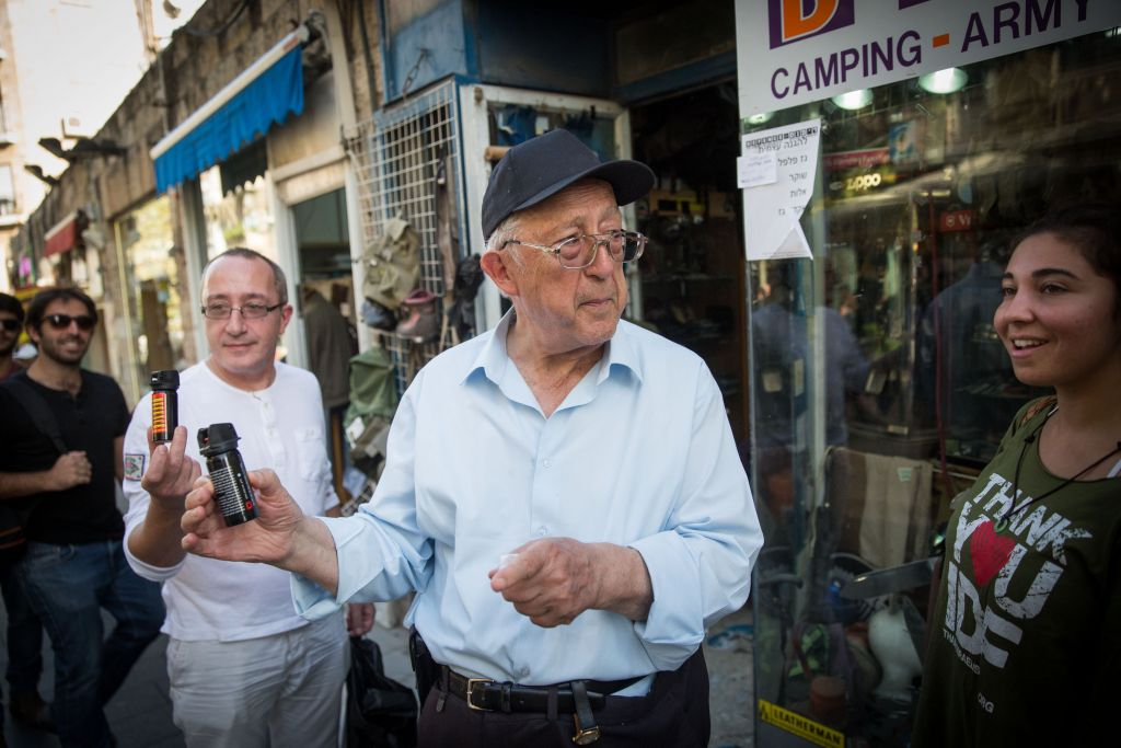 An older Israeli shows off his newly purchased pepper spray, in central Jerusalem (Hadas Parush/Flash 90)