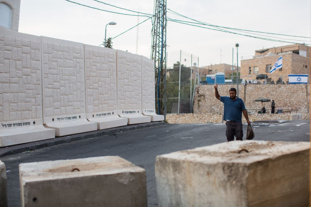 Five of the six concrete slabs placed between Jerusalem's (Jewish) East Talpiot and (Arab) Jabel Mukaber neighborhoods, October 18, 2015 In the foreground, concrete blocks at the entrance to Jabel Mukaber. (Photo by Yonatan Sindel/Flash90)