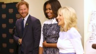 Britain's Prince Harry, first lady Michelle Obama and Jill Biden tour the USO Warrior and Family Center at the Fort B