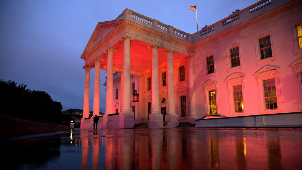 The North Portico of the White House is illuminated pink in honor of Breast Cancer Awareness Month, October 15, 2014. (Official White House photo/Chuck Kennedy)