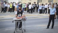 A paramedic rushing to the scene where two terrorists were shot by police after attempting to carry out a stabbing attack. JTA