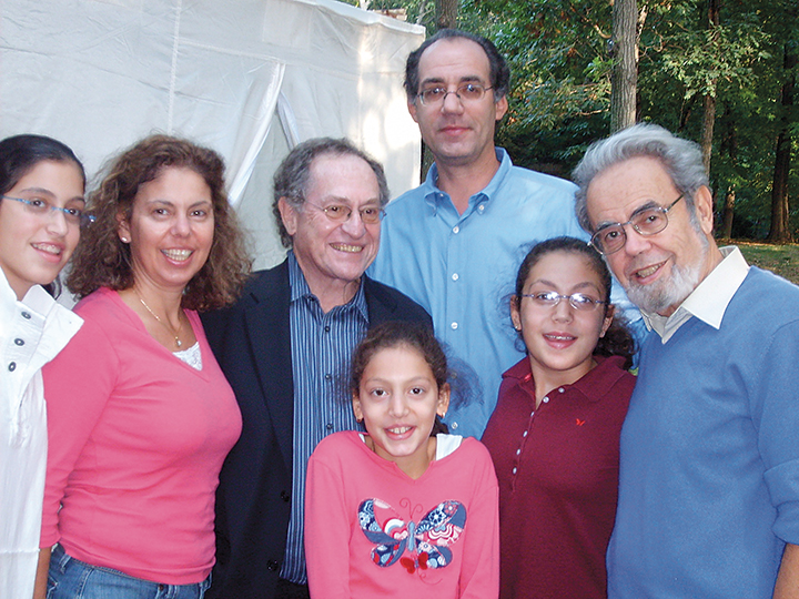 From left, Sarah Sichel; her mother, Dana Cernea; Alan Dershowitz, and Dana's husband, Eric Sichel, stand shoulder to shoulder in 2006. Below them, sisters Elana and Rebecca Sichel stand next to their grandfather, Michael Cernea.