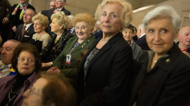 Holocaust survivors attending an event at the U.S. Capitol building in Washington, D.C., honoring the victims of Nazi persecutio