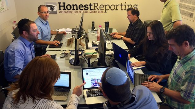 Simon Plosker, top left, managing editor of HonestReporting.com, directing his monitoring team at his organization. JTA
