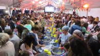 More than 1,700 Jewish women knead dough under a tent during the Great Big Challah Bake on Oct. 21, 2015 in Cape Town. RNS