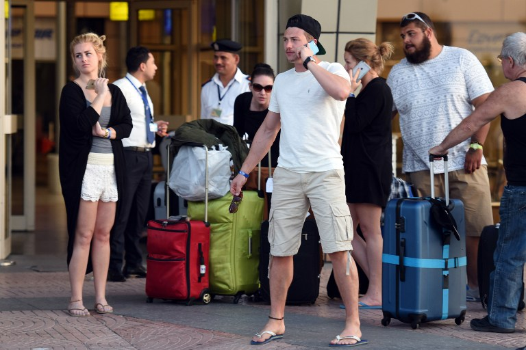 British tourists arrive at the airport in Egypt's Red Sea resort of Sharm El-Sheikh on November 6, 2015. (Mohamed el-Shahed/AFP)
