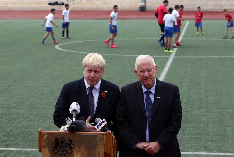 "President Reuven Rivlin (R) and Mayor of London, MP Boris Johnson, deliver a speech as they launch the new football season of the ""Equalizer"" organization in Jerusalem, which works with Jewish and Arab children across the country, on November 10, 2015. (Gali Tibbon/AFP)"