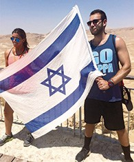 Myles Field and his sister, Dayna, wave an Israeli flag during a visit there.