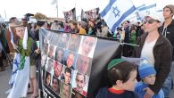 Protesters this week in Gush Etzion holding a poster of Israelis killed in terrorist attacks. Ben Sales/JTA