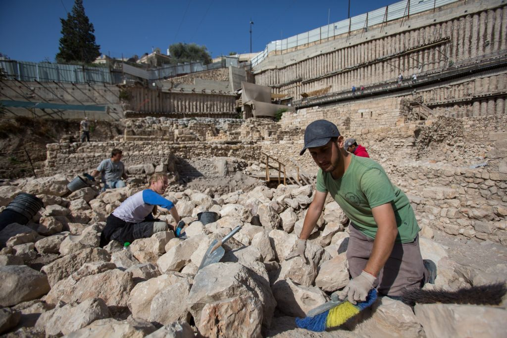 Archaeologists work near remains of the Acra citadel and tower in the City of David in Jerusalem. (Yonatan Sindel/Flash90)