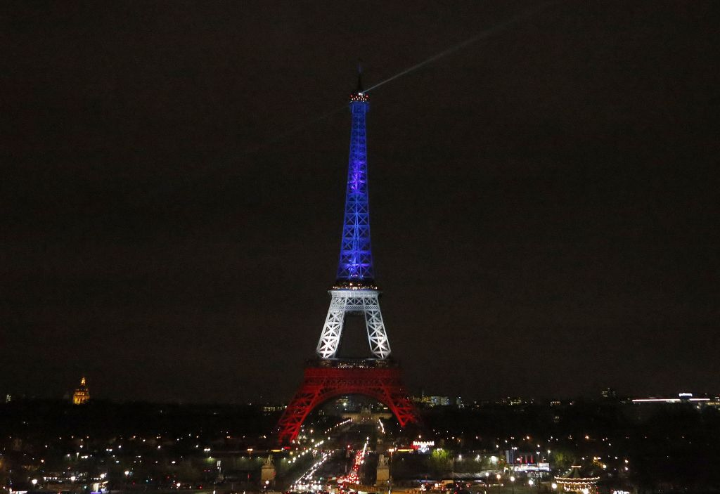 The Eiffel Tower is illuminated in the French national colors red, white and blue in honor of the victims of the terror attacks last Friday in Paris, Monday, Nov. 16, 2015 (AP Photo/Frank Augstein)