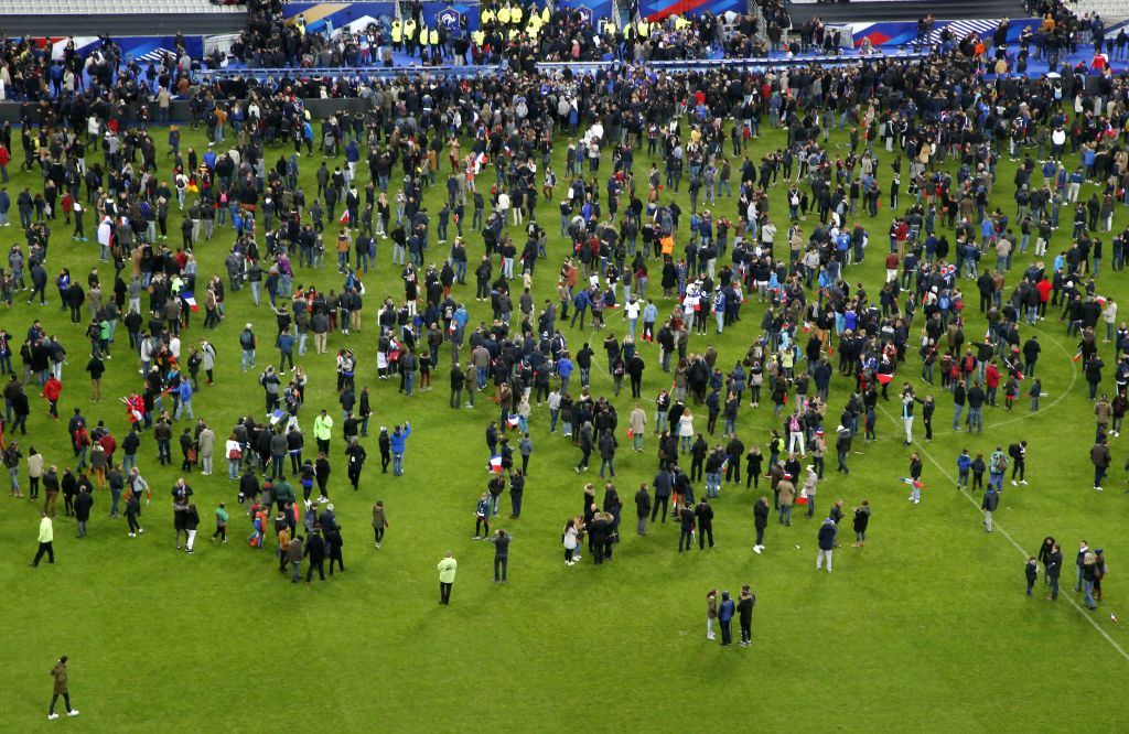 Spectators invade the pitch of the Stade de France stadium after the international friendly soccer France against Germany, Friday, Nov. 13, 2015 in Saint Denis, outside Paris. (AP Photo/Michel Euler)