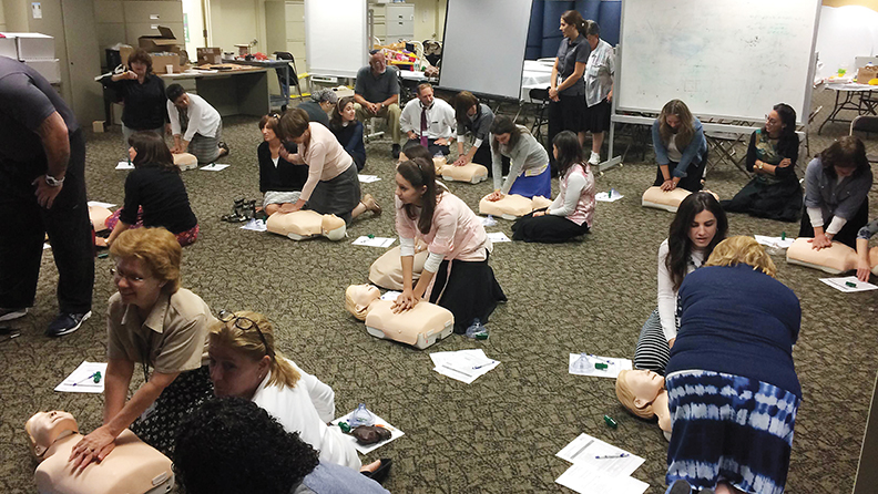 Sinai staff learn CPR with sophisticated simulation devices from Holy Name.