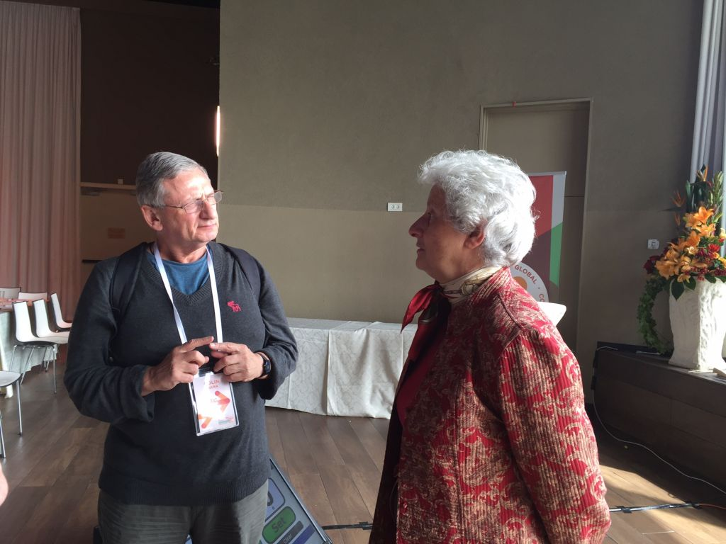 Colin Bulka from London's JW3 community center (left) speaks with Dr. Diana Pinto at the Jerusalem-based JCC Global 2015 conference on November 5, 2015. (Amanda Borschel-Dan/The Times of Israel).