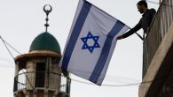 A Jewish-Israeli raising the flag of Israel near the Old City of Jerusalem. The number of Jewish residents in the Old City. JTA