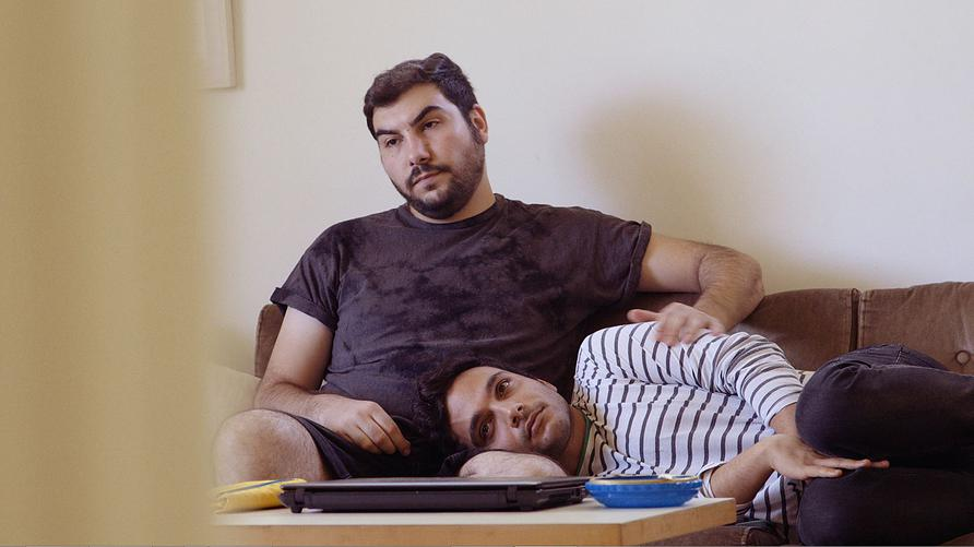 Palestinian Khader Abu-Seif (striped shirt) with his Jewish partner, David, in British director and producer Jake Witzenfeld's 'Oriented,' the story of three Palestinian gay men in Tel Aviv. (courtesy)