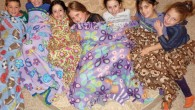 Hayden, Rosenthul, Maron and Paulen children with handmade blankets that will go to needy youngsters.