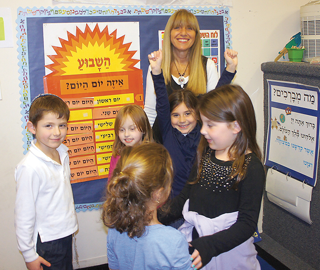 Dr. Tani Foger spends time in a first-grade classroom at Yeshivat He'Atid.