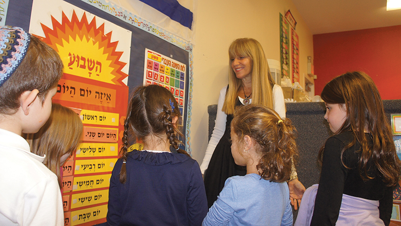Dr. Tani Foger at a first-grade classroom at Yeshivat He'Atid.