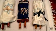 These three Torahs will be exhibited Sunday at Ohab Zedek as part of Kristallnacht observance. Courtesy of Jewish Heritage Found